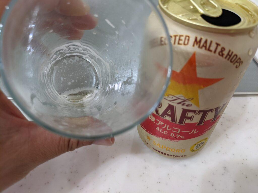 飲み終わったサッポロザ・ドラフティのコップ